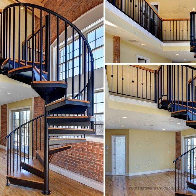 别墅室内钢木旋转楼梯 复式楼碳钢旋转楼梯图片